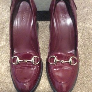 Gucci wine red patent penny loafer with heel.